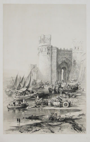 [A Moorish gateway through a Spanish town's walls.]