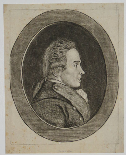 [Portrait of a man in an oval border.]